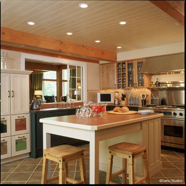 Planked kitchen ceiling by Yankee Barn Homes