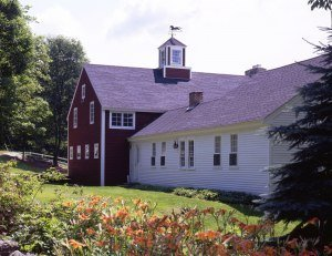 This New England cape built i nthe 1700's has a barn addition built in the year 2005.