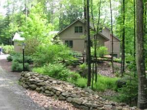 Yankee Barn Homes - timber framebarn home in the woods