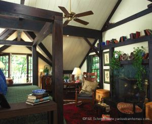 The post and beam structure plays a strong role in the master bedroom.