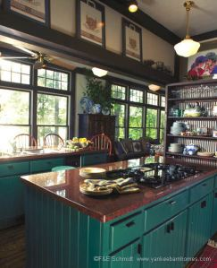 Notice the jewel tones carry over to the kitchen cabinets.