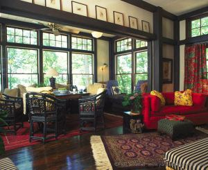 The jewel tones, the deep rich color of the timbers, floor and rattan furniture and the beautiful oriental rugs all combine perfectly in the great room.