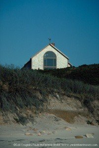 A post and beam sits above the beach on Block Island.