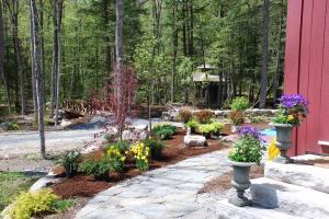 The patio garden installation begins.