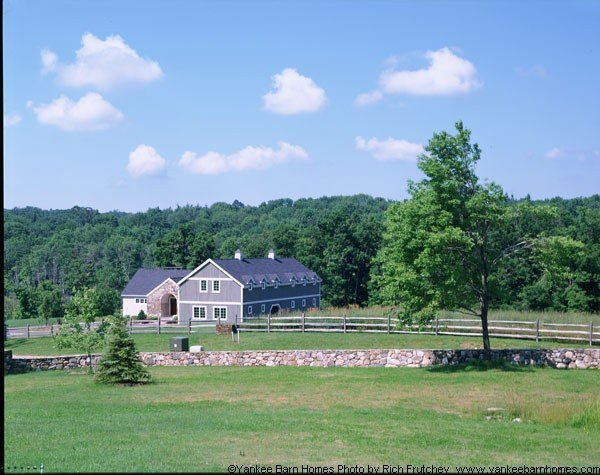 A barn home with a classic barn shaped silhouette
