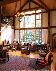 The great room is vast yet warm and perfectly positioned to look out on the lake..