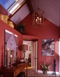 Benjamin Moore's Spiced Pumpkin creates an element of surprise in the entryway.