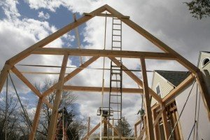 The post and beam barn addition framing goes up.