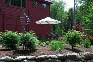 The patio garden as seen from below the stone retaining wall.