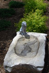 This granite bird bath is used by our Boxer, Deacon, as his personal water bowl.