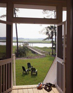 Out the screen door awaits warm breezes and the soothing sounds of the lapping tide.