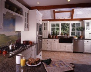 The new kitchen includes a custom design from the company Crown Point Cabinetry.